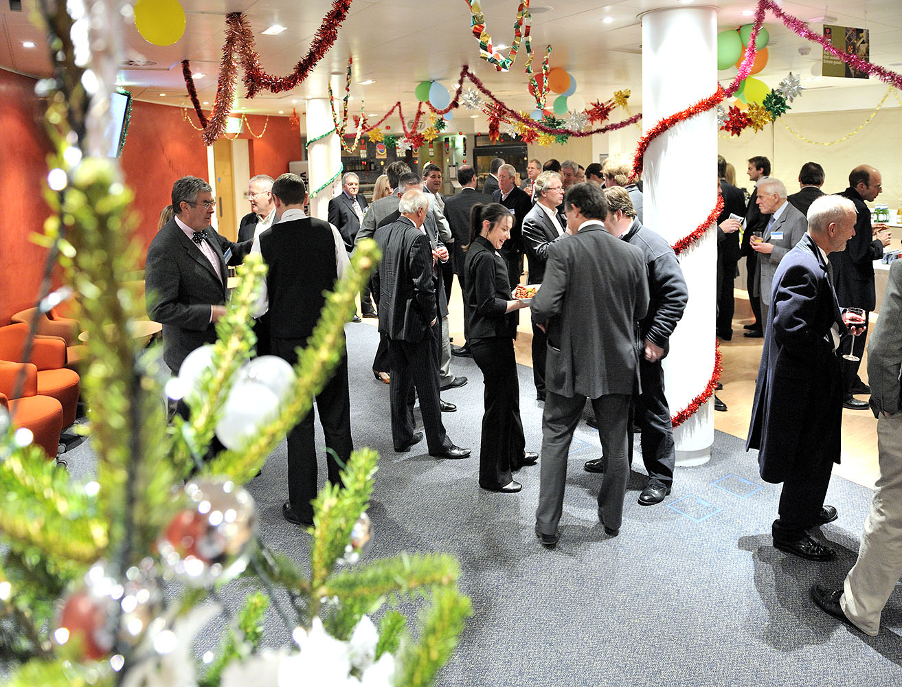 Event photography, image of a Christmas event, people chatting