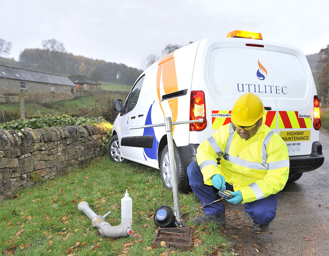 Location photography, engineer works next to his van in a rural locaction